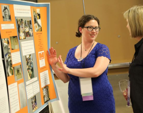 An image of Elizabeth presenting a poster at the Society of American Archivists 2019 Convention.